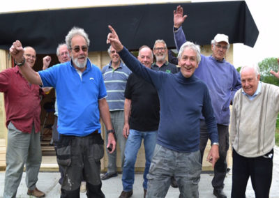 Shedders hands up after build